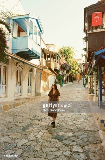 woman walking on the street of kas, turkey - kas stock pictures, royalty-free photos & images