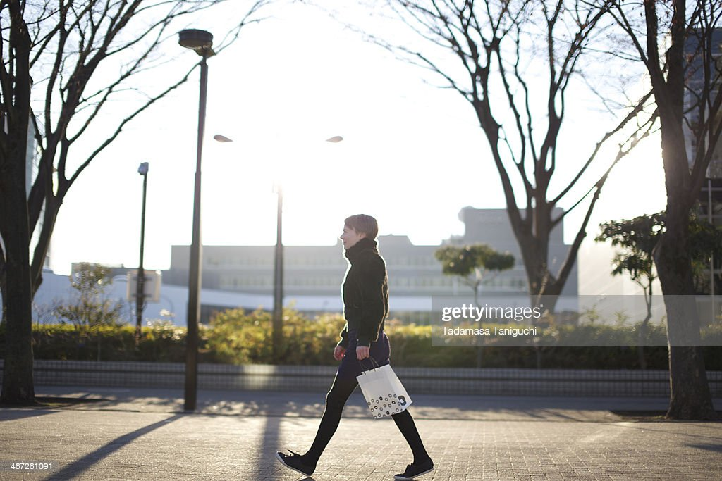 Woman walking on the street : Stock Photo
