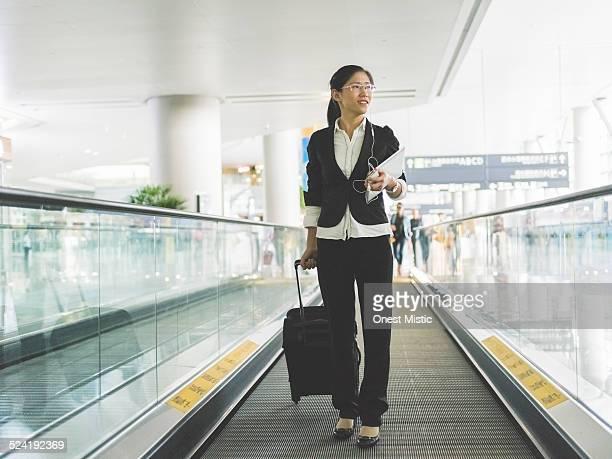 Woman walking on travelator at airport
