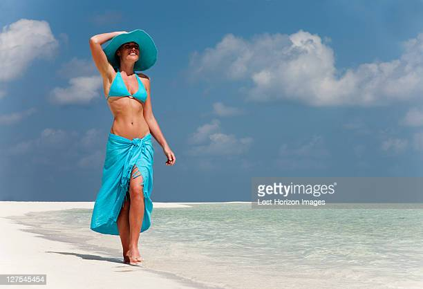 woman walking on tropical beach - sarong stock photos and pictures