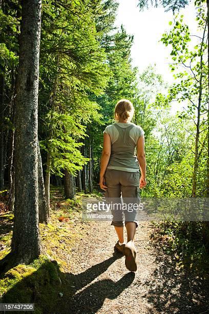 Woman walking on woods