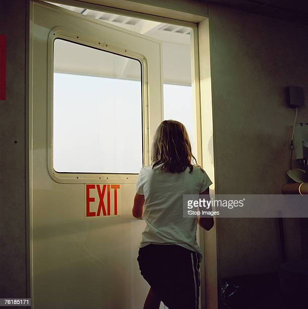 Woman walking out a door