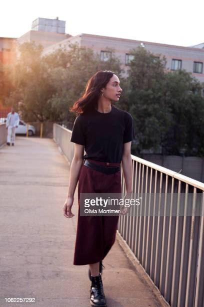 Woman walking over a bridge in the city