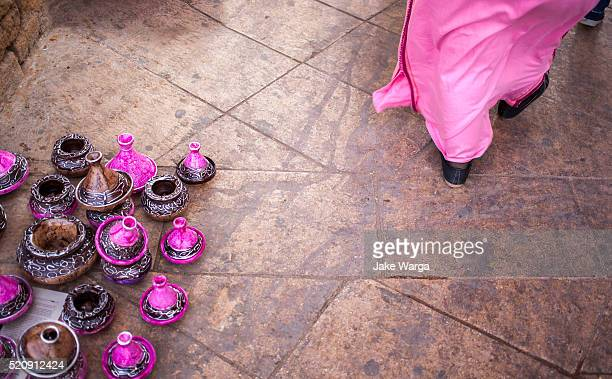 woman walking past pottery, safi, morocco - jake warga stock pictures, royalty-free photos & images