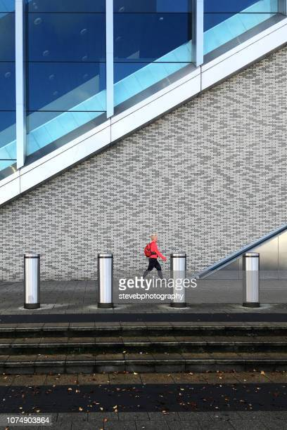 woman walking - stevebphotography stock pictures, royalty-free photos & images