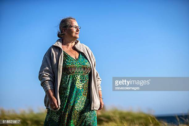 woman walking - fat old lady stock photos and pictures