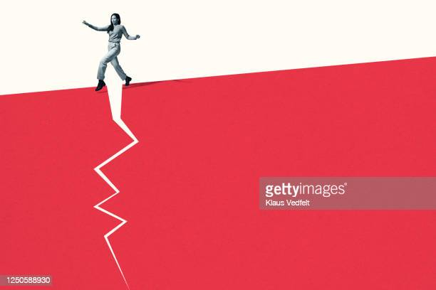 woman walking stealthily on broken red footpath - risk stock pictures, royalty-free photos & images