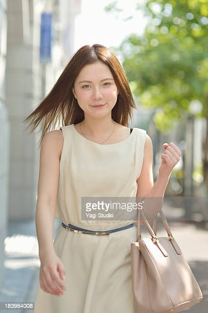 woman walking the streets of kyoto - sleeveless stock pictures, royalty-free photos & images