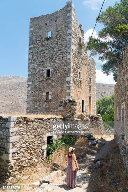 woman walking though an abandoned village - peloponnese stock photos and pictures