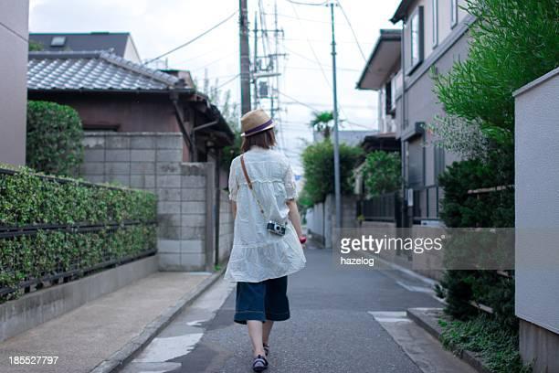 Woman walking through a residential area
