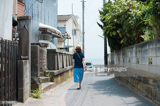 Woman walking through a seaside residential area