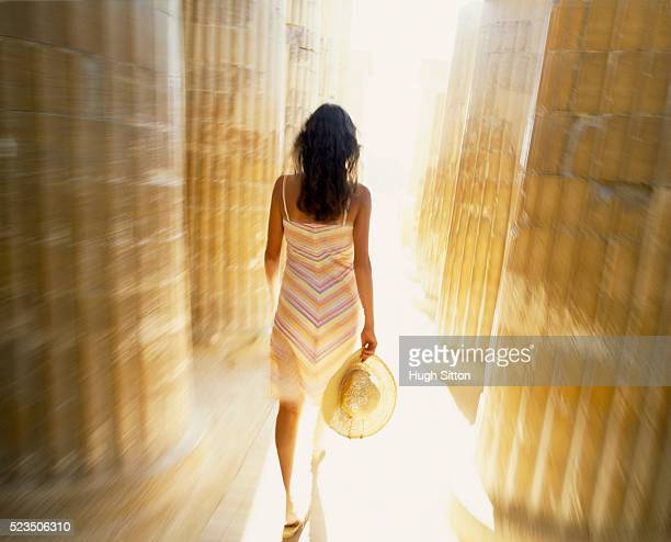 woman walking through columns - hugh sitton stock pictures, royalty-free photos & images