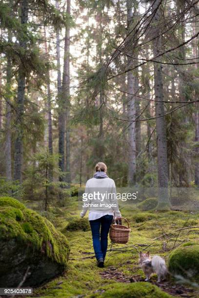 Woman walking through forest
