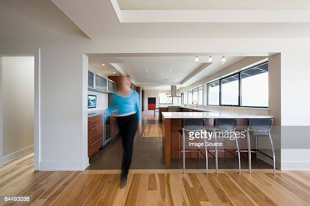 woman walking through kitchen - female streaking stock pictures, royalty-free photos & images