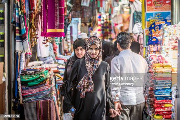 woman walking through market - muscat governorate stock pictures, royalty-free photos & images