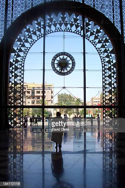 Woman walking through Muslim crystal arch