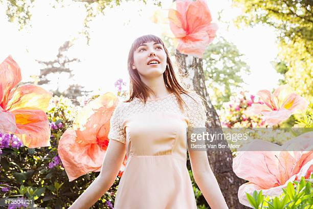 woman walking through nature with superflowers. - dreaming stock pictures, royalty-free photos & images