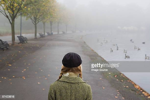 Woman walking through park