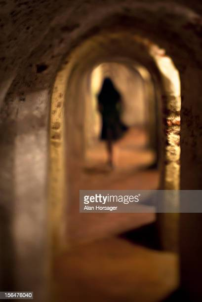 Woman walking through tunnels