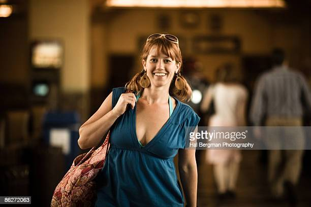 woman walking through union station - dress cleavage stock pictures, royalty-free photos & images
