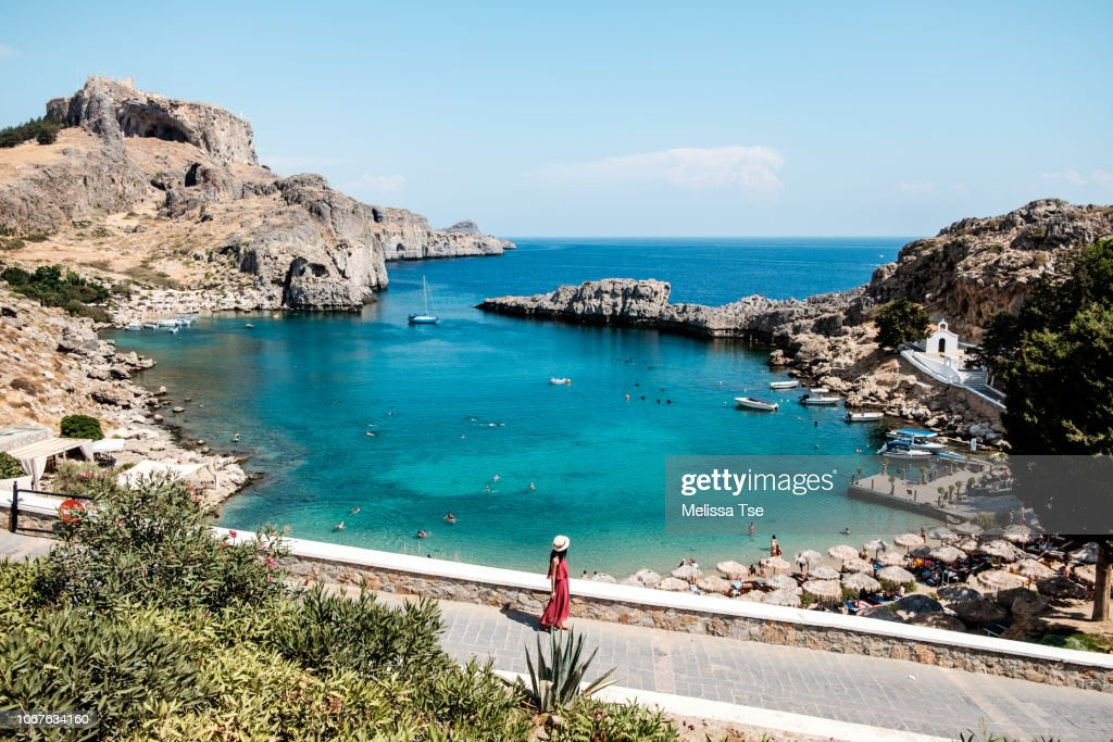 Woman Walking to Saint Paul's Bay in Lindos, Greece : Stock Photo