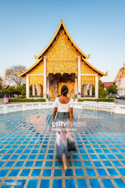 woman walking to the temple, chiang mai, thailand - chiang mai province stock photos and pictures