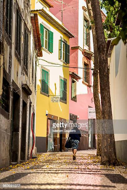 woman walking up rua da conceição - funchal stock pictures, royalty-free photos & images