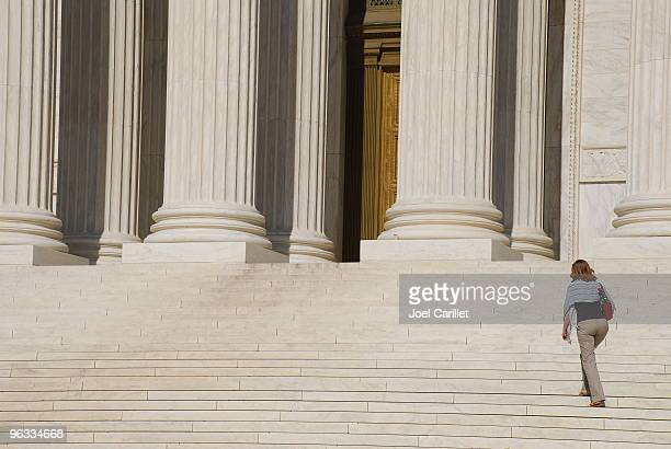 woman walking up steps of us supreme court - lady justice stock pictures, royalty-free photos & images