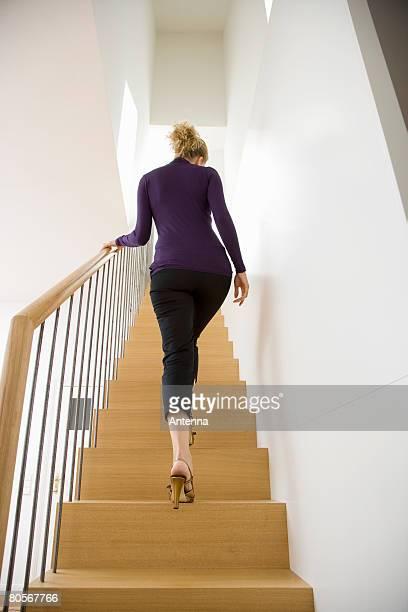 A woman walking upstairs