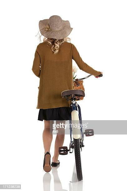 Woman walking with a bicycle