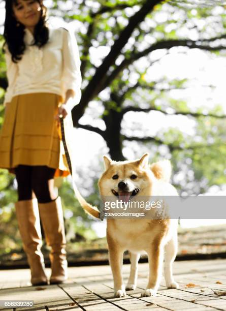 Woman Walking with a Dog