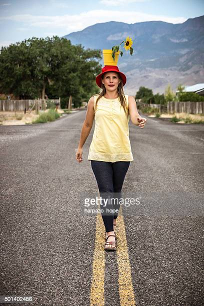 Woman Walking with a Flower Pot on her Head