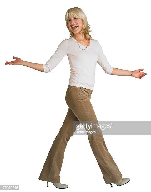 woman walking with arms outstretched - striding stock pictures, royalty-free photos & images