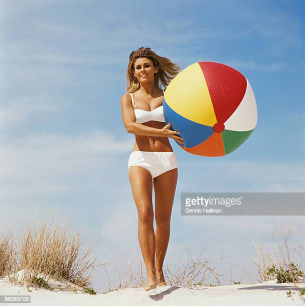Woman walking with beach ball