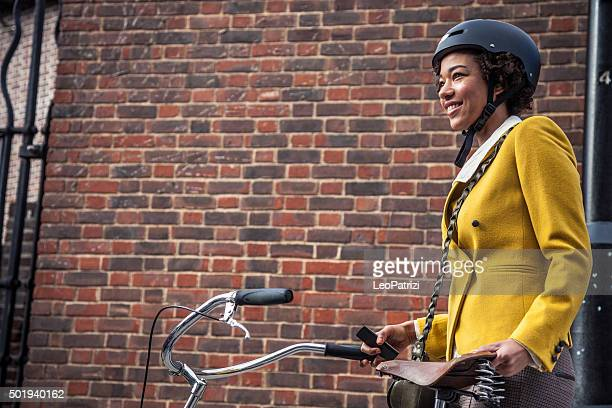 woman walking with bicycle in central london - cycling helmet stock photos and pictures