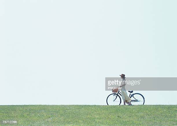 Woman walking with bicycle