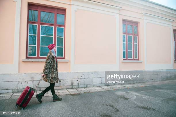 woman walking with her suitcase - showus stock pictures, royalty-free photos & images