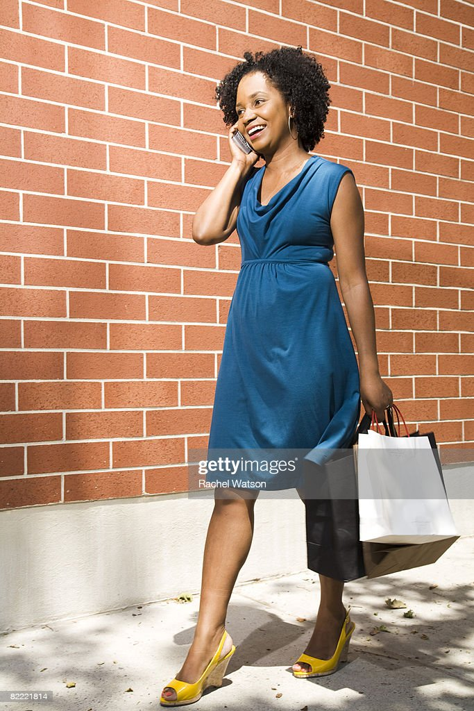 woman walking with shopping bags and  : Stock Photo