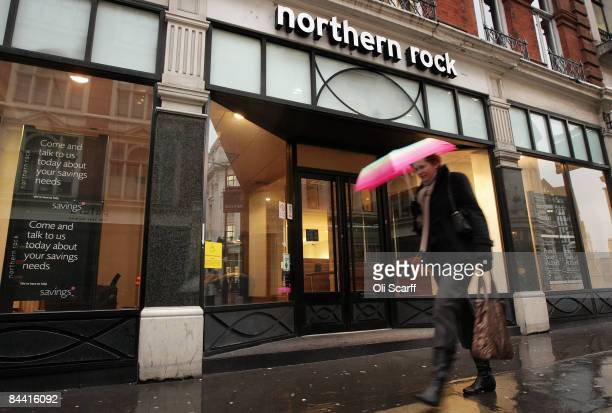 A woman walks a branch Northern Rock on January 23 2009 in London England The troubled bank which received a substantial bail out from the UK...