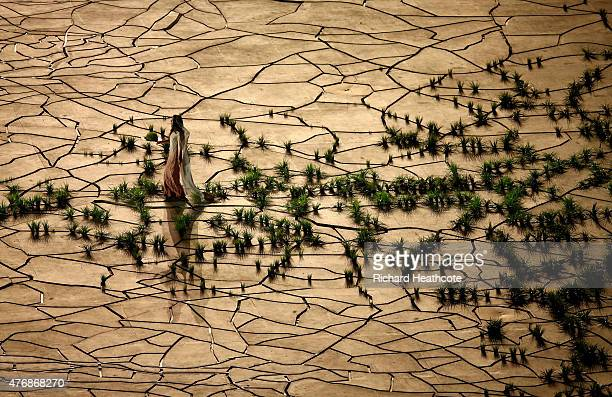 Woman walks across a barren landscape during the Opening Ceremony for the Baku 2015 European Games at the Olympic Stadium on June 12 2015 in Baku...
