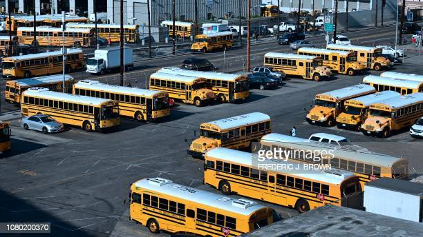 A woman walks across a Los Angeles Unified School District school bus parking lot in Los Angeles California on January 10 2019 A judge has rejected...