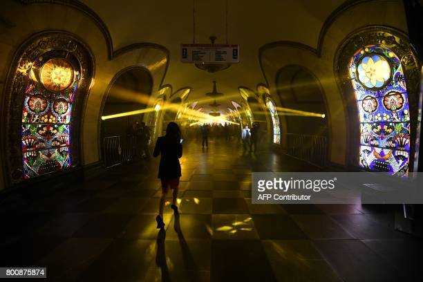 A woman walks along a platform before a special night performance by 'The Kremlin ballet' troupe in the Novoslobodskaya metro station in Moscow on...