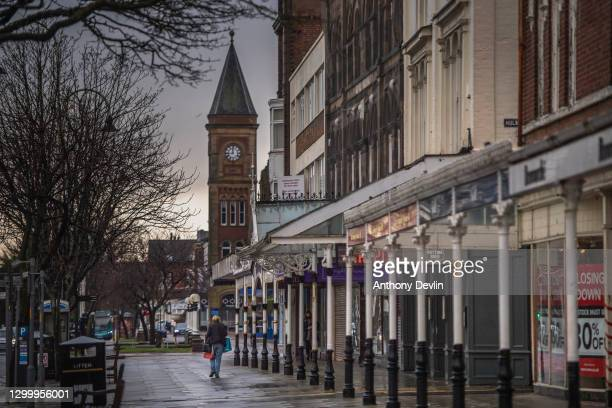 Woman walks along an empty Lord Street on February 02, 2021in Southport, United Kingdom. Health authorities have found more than 100 cases of a...