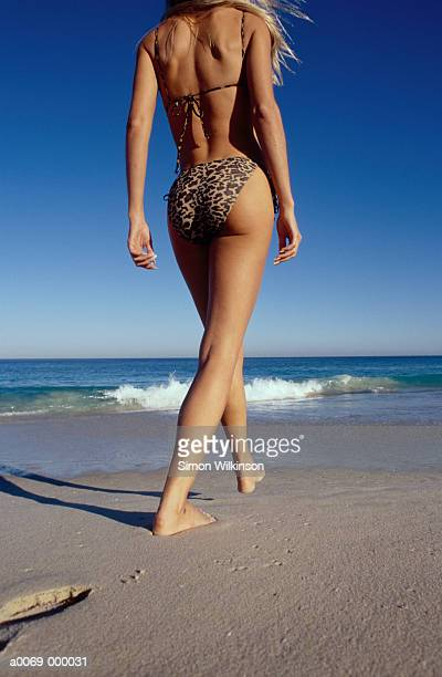 Woman Walks Along Beach