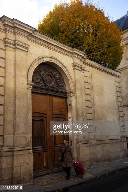 Woman walks along rue des Archives in the Marais district of Paris, France on November 6, 2019.