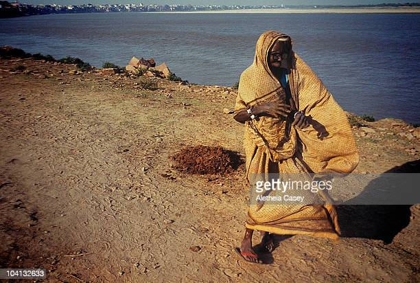 A woman walks along the banks of the Ganges River one of the most polluted rivers in the world on October 22 2009 in Varanasi India Originating in...