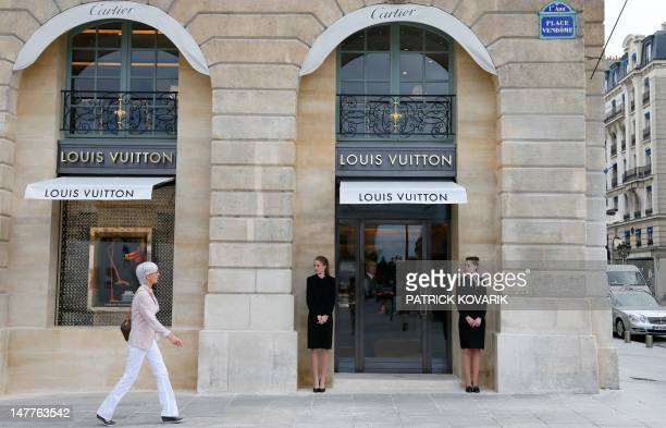 A woman walks along the first Louis Vuitton jewellery store opened in the prestigious jewellery area place Vendome on July 3 2012 in Paris Louis...