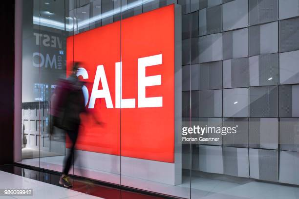 A woman walks along the lettering 'Sale' on June 23 2018 in Berlin Germany