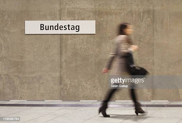 A woman walks along the platform at Bundestag station of the U55 commuter train in Mitte district on October 12 2011 in Berlin Germany Mitte district...