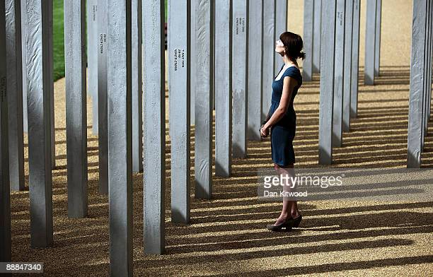 A woman walks around a new permanent memorial to honour the victims of the July 7 2005 London bombings in Hyde park on July 6 2009 in London England...